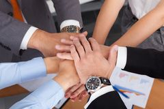 Businesspeople stacking their hands Royalty Free Stock Images