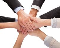 Businesspeople stacking their hands together Stock Photos