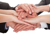 Businesspeople stacking their hands together Stock Photo