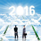 Businesspeople on the stairs with numbers 2016 Royalty Free Stock Image
