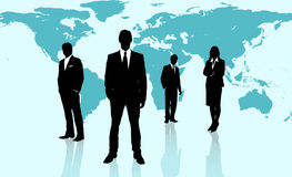 Businesspeople standing against a blue world map Stock Photography