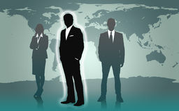 Businesspeople standing against a world map Stock Image