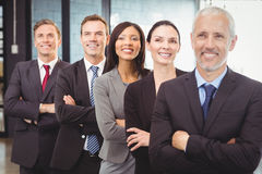 Businesspeople standing with arms crossed Stock Images