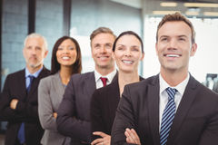 Businesspeople standing with arms crossed Stock Photo