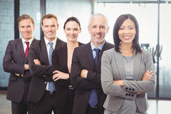 Businesspeople standing with arms crossed Royalty Free Stock Photo