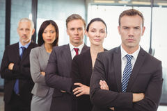 Businesspeople standing with arms crossed Royalty Free Stock Image