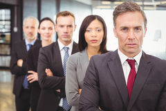 Businesspeople standing with arms crossed Royalty Free Stock Photos