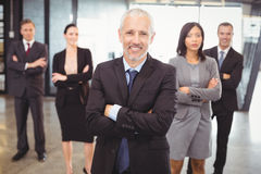 Businesspeople standing with arms crossed Stock Photos