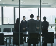 Businesspeople Standing in Conference Room Stock Photography