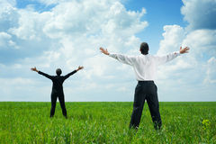 Businesspeople standing on green grass Royalty Free Stock Images