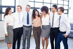 Businesspeople standing together in office Stock Photo