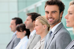 Businesspeople stood in a row Stock Photo