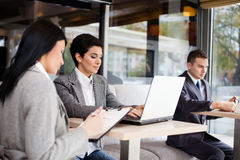 Businesspeople. Success businesspeople working at cafe royalty free stock photos