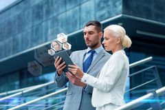 Businesspeople with tablet pc outdoors Royalty Free Stock Photography