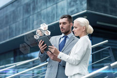 Businesspeople with tablet pc outdoors Royalty Free Stock Images