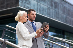 Businesspeople with tablet pc outdoors Stock Photo