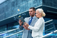 Businesspeople with tablet pc outdoors Stock Photos
