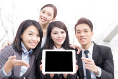 Businesspeople take tablet show something Stock Images