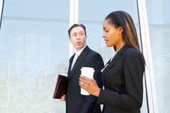 Businesspeople With Takeaway Coffee Outside Office Stock Image