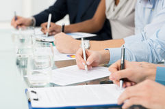 Businesspeople Taking Notes stock photo