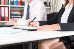 Businesspeople taking notes Royalty Free Stock Photography