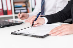 Businesspeople taking notes Royalty Free Stock Photos