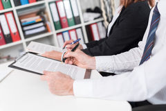 Businesspeople taking notes Stock Photography