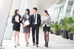 Businesspeople talk in office. In hongkong stock image