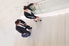 Businesspeople talking as they walk into the office Royalty Free Stock Photography