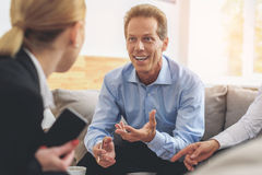 Businesspeople talking in corporate office stock image