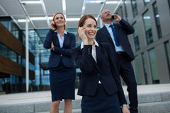 Businesspeople talking on mobile phones Royalty Free Stock Image