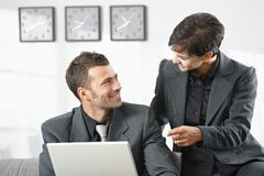 Businesspeople talking at office Royalty Free Stock Photos
