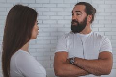 Businesspeople talking at the office. Bearded mature men talking to his female colleague at the office. Businesspeople discussing work together. Male royalty free stock images