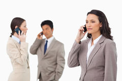 Businesspeople talking on the phone. Against a white background stock image
