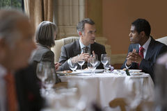 Businesspeople Talking At Restaurant Table Stock Image