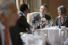 Businesspeople Talking At Restaurant Table Stock Photos