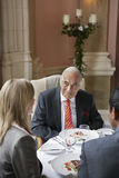 Businesspeople Talking At Restaurant Table Stock Images