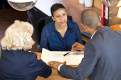 Businesspeople Talking To Receptionist Stock Photos