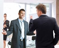 Businesspeople talking. Young businessmen talking at meetingroom, smiling happy Stock Photo