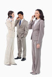Businesspeople on their cellphones. Against a white background Stock Photography