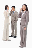Businesspeople on their phones Stock Images