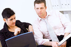 Businesspeople thinking together Stock Images