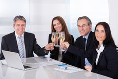 Businesspeople Toasting Champagne Stock Image