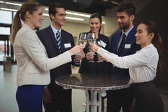 Businesspeople toasting glasses of champagne Royalty Free Stock Photos