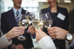 Businesspeople toasting glasses of champagne. In office Stock Images