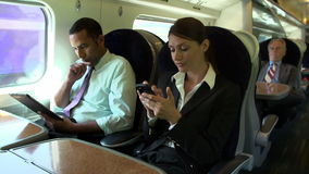 Businesspeople On Train Using Digital Devices stock video footage