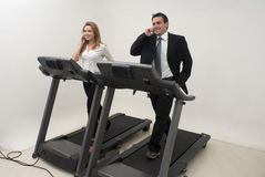 Businesspeople on Treadmill - Horizontal Stock Image