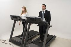 Businesspeople on Treadmill - Horizontal Stock Photos