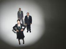 Businesspeople Under Spotlight Stock Images
