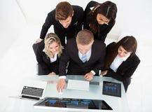 Businesspeople Using Desktop Pc At Desk Stock Photos